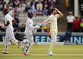 7th September 2017, Lords Cricket Ground, London, England; International Test Match Series, Third Test, Day 1; England versus West Indies; England Bowler James Anderson reacts after he is hit for four