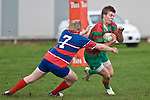 Steven Kennedy tries to avoid the tackle of Bruce John. Counties Manukau Premier rugby game between Waiuku & Ardmore Marist played at Waiuku on Saturday May 10th 2008..Ardmore Marist won 27 - 6 after leading 10 - 6 at halftime.