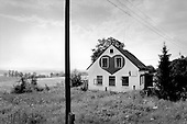 Nebesa, Czech Republic.July 1997.Near the Germany border dozens of abandoned houses are  being used as bordellos to provide inexpensive prostitutes for Germans. This house is located on a quite and off the track country road near the border..