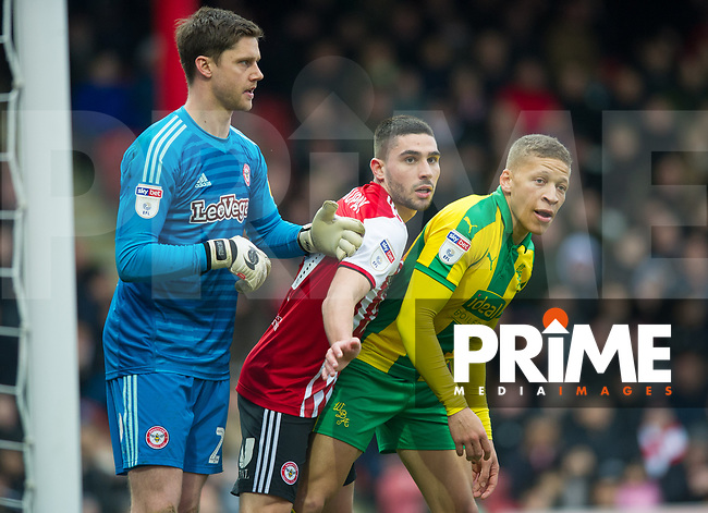 Brentford Neal Maupay and WBA's Dwight Gayle during the Sky Bet Championship match between Brentford and West Bromwich Albion at Griffin Park, London, England on 16 March 2019. Photo by Andrew Aleksiejczuk / PRiME Media Images.