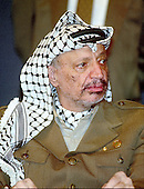 "Palestinian Liberation Organization (PLO) Chairman Yasser Arafat appears at the National Press Club in Washington, D.C. on September 14, 1993.  Arafat made a statement and took questions from the press on the day following the signing of the ""Oslo 1"" accord with Israel on the South Lawn of the White House..Credit: Ron Sachs / CNP"