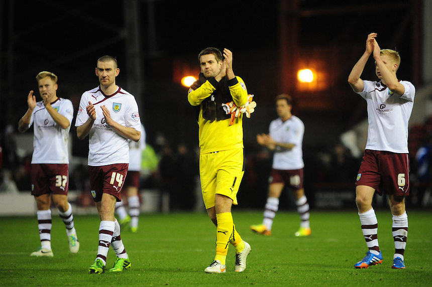 Burnley players, from left, Scott Arfield, David Jones, Thomas Heaton and Ben Mee applaud the fans at the final whistle<br /> <br /> Photo by Chris Vaughan/CameraSport<br /> <br /> Football - The Football League Sky Bet Championship - Nottingham Forest v Burnley - Saturday 23rd November 2013 - The City Ground - Nottingham<br /> <br /> &copy; CameraSport - 43 Linden Ave. Countesthorpe. Leicester. England. LE8 5PG - Tel: +44 (0) 116 277 4147 - admin@camerasport.com - www.camerasport.com