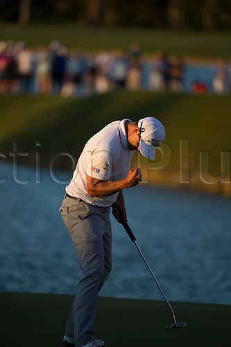 06.03.2016. Doral, Florida, USA. Adam Scott of Australia pumps his fist after sinking his putt at the 18th hole to win the final round of the World Golf Championships-Cadillac Championship on the TPC Blue Monster course at the Trump Doral Golf Club and Resort in Doral, FL.
