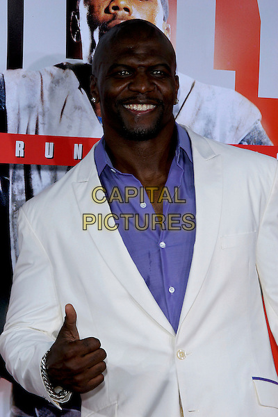 "TERRY CREWS.World Premiere of ""The Longest Yard"" held at Grauman's Chinese Theatre..May 19th, 2005.Photo Credit: Jacqui Wong/AdMedia.half length purple shirt thumbs up hand gesture.www.capitalpictures.com.sales@capitalpictures.com.© Capital Pictures."