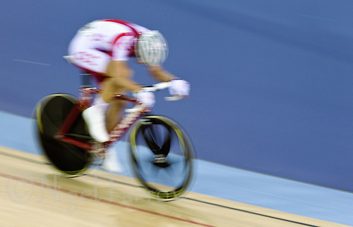 17 FEB 2012 - LONDON, GBR - Poland's Mateusz Nowak (POL) finds himself alone during the Men's Points Race final at the UCI Track Cycling World Cup and London Prepares test event for the 2012 Olympic Games in the Olympic Park Velodrome in Stratford, London, Great Britain (PHOTO (C) 2012 NIGEL FARROW)