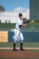 Surprise Saguaros relief pitcher Blake Weiman (55), of the Pittsburgh Pirates organization, gets ready to deliver a pitch during an Arizona Fall League game against the Salt River Rafters on October 9, 2018 at Surprise Stadium in Surprise, Arizona. Salt River defeated Surprise 10-8. (Zachary Lucy/Four Seam Images)