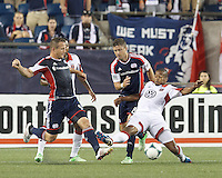 D.C. United defender Ethan White (15) works to clear ball as New England Revolution substitute forward Chad Barrett (9) and New England Revolution defender Chris Tierney (8) buzz. In a Major League Soccer (MLS) match, the New England Revolution (blue) tied D.C. United (white), 0-0, at Gillette Stadium on June 8, 2013.