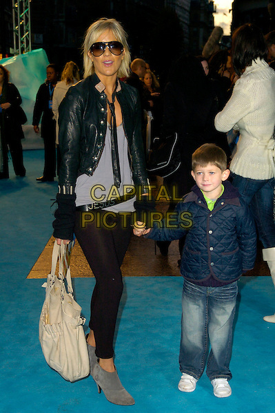 "KATE LAWLER & GUEST.Attends the European Film Premiere of ""Happy Feet"" .Empire Cinema, leicester Square, London, England,.November 26th 2006..full length sunglasses  black leather jacket leggings grey ankle boots bag tie wrist warmers child boy kid holding hands.CAP/CAN.©Can Nguyen/Capital Pictures"