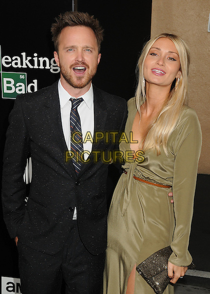 Aaron Paul, Lauren Parsekian<br /> &quot;Breaking Bad&quot; Final Episodes Los Angeles Premiere Screening held at Sony Pictures Studios, Culver City, California, USA, 24th July 2013.<br /> half length grey gray black suit tie green khaki dress belt arm around long sleeve <br /> CAP/ADM/BP<br /> &copy;Byron Purvis/AdMedia/Capital Pictures