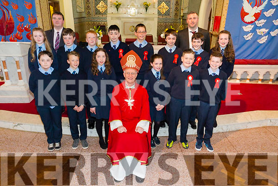 The pupils from Faha NS with Bishop Ray Browne l at their Confirmation in Milltown on Tuesday