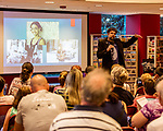 July 26, 2017. Raleigh, North Carolina.<br /> <br /> Alan Gratz showed some of the photos that inspired the stories in his new book &quot;Refugee&quot;.<br /> <br /> Author Alan Gratz spoke about and signed his new book &quot;Refugee&quot; at Quail Ridge Books. The young adult fiction novel contrasts the stories of three refugees from different time periods, a Jewish boy in 1930's Germany , a Cuban girl in 1994 and a Syrian boy in 2015.