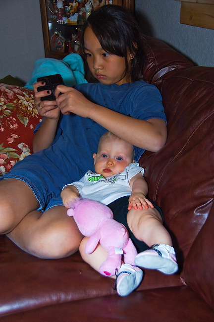 teenager and infant sharing the sofa