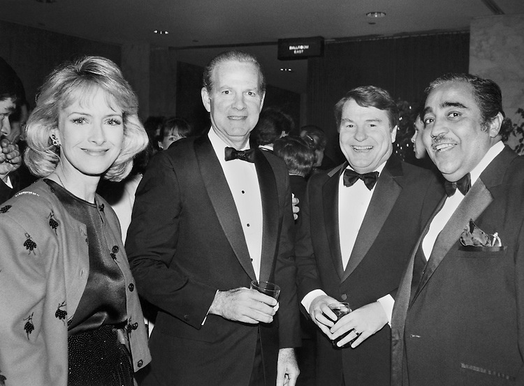 "Judith ""Judy"" Woodruff, news anchor, Sec. James Addison Baker III, Secretary of the Treasury, James Charles ""Jim"" Lehrer, journalist, and Charles Bernard ""Charlie"" Rangel, D- N.Y. stand together at the TV and Radio Correspondents Dinner. April 1998 (Photo by Neshan Naltchayan/CQ Roll Call)"