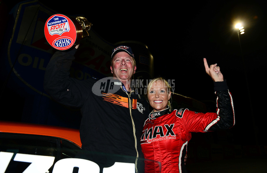 Sept. 16, 2012; Concord, NC, USA: NHRA stock driver Dan Fletcher celebrates after winning the O'Reilly Auto Parts Nationals at zMax Dragway. Mandatory Credit: Mark J. Rebilas-
