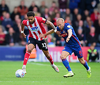 Lincoln City's Bruno Andrade vies for possession with Sunderland's Dylan?McGeouch<br /> <br /> Photographer Andrew Vaughan/CameraSport<br /> <br /> The EFL Sky Bet League One - Lincoln City v Sunderland - Saturday 5th October 2019 - Sincil Bank - Lincoln<br /> <br /> World Copyright © 2019 CameraSport. All rights reserved. 43 Linden Ave. Countesthorpe. Leicester. England. LE8 5PG - Tel: +44 (0) 116 277 4147 - admin@camerasport.com - www.camerasport.com