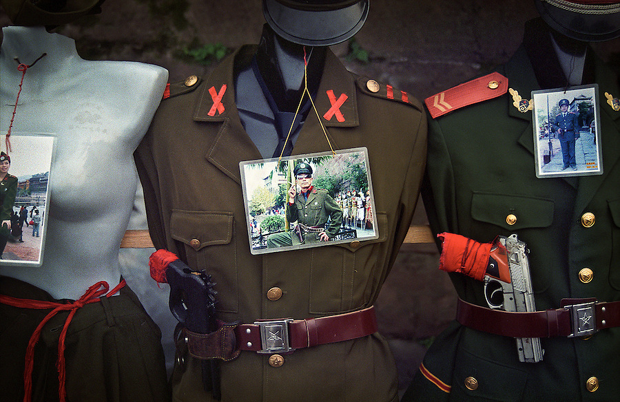 Military uniforms for rent for visiting tourists in Fenghuang in the Hunan Province, China.