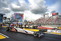 Mar. 9, 2012; Gainesville, FL, USA; NHRA top alcohol dragster driver Rich McPhillips (near) races alongside Duane Shields during qualifying for the Gatornationals at Auto Plus Raceway at Gainesville. Mandatory Credit: Mark J. Rebilas-
