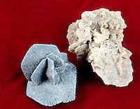 GYPSUM: SAND SELENITE (DESERT ROSE) VARIETY<br /> Crystalline Gypsum - rosette aggregate; Monoclinic Crystal; CaSO4.2H2O. <br />  Gray specimen is stained with petroleum.