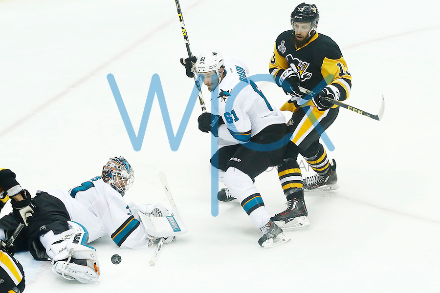 Martin Jones #31 of the San Jose Sharks makes a save in front of Nick Bonino #13 of the Pittsburgh Penguins in the second period during game five of the Stanley Cup Final at Consol Energy Center in Pittsburgh, Pennsylvania on June 9, 2016. (Photo by Jared Wickerham / DKPS)