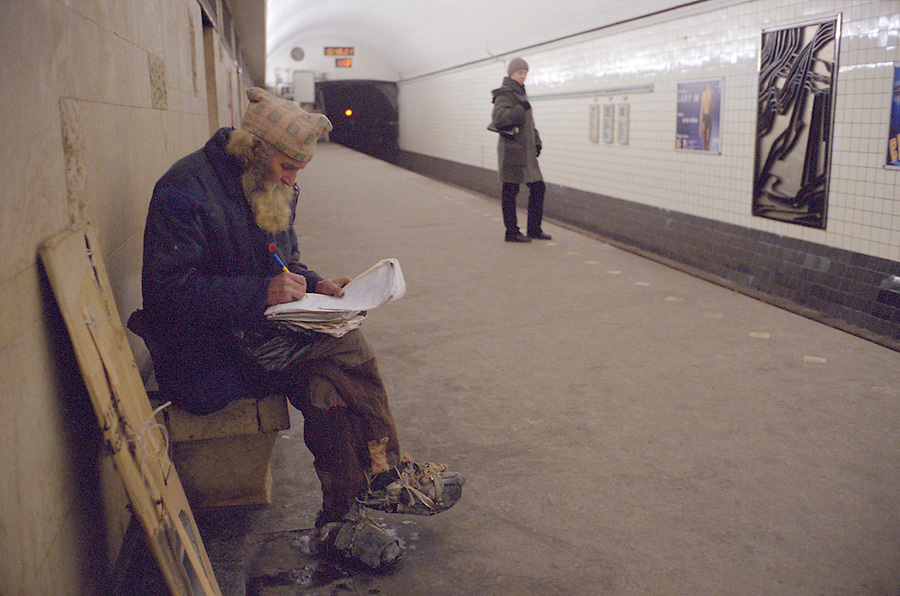 St Petersburg, Russia, January 2003..A homeless man in a metro station during an unusually cold period when temperatures in the city fell to -35 Celcius..