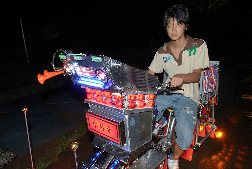 "Yuji Yoshida (14) riding his decochari customized bicycle. ""It's got 50 lights on there now. The battery runs out after about 30 minutes."""