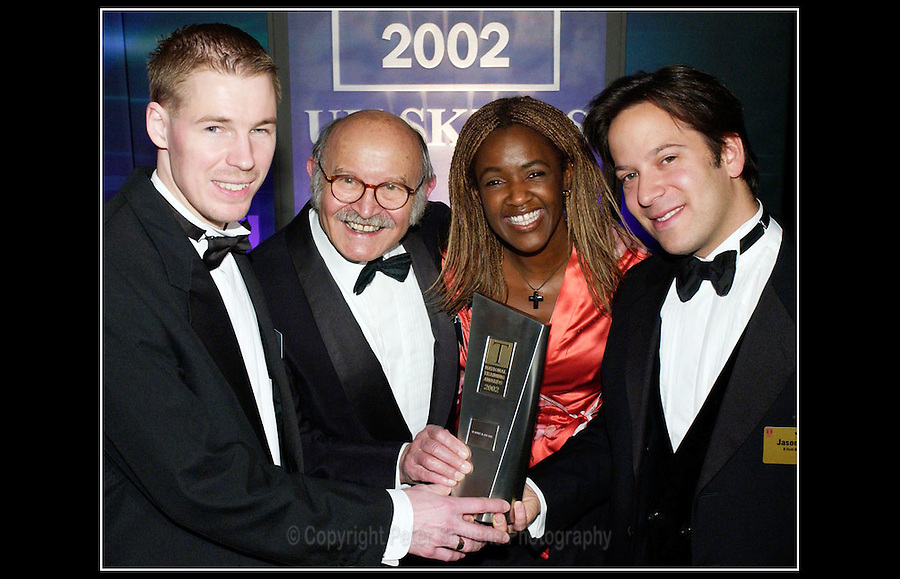 National Training Awards 2002 - Diane Louise Jordan presents trophy to R Hold Co Ltd at The Guildhall, City of London - 14th November 2002 - <br /> <br /> The National Training Awards are managed by UK Skills on behalf of the Department of Business, Innovation and Skills in England and in partnership with the Department for Employment and Learning Northern Ireland, the Welsh Assembly Government, Skills Development Scotland and the Scottish Government.