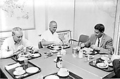"Astronaut John H. Glenn, Jr. (center) eats breakfast on February 20, 1962 prior to his launch from Cape Canaveral, Florida into Earth-orbit aboard Friendship 7.  Dr. William K. Douglas is at right.  Unidentified person at left may be Astronaut Donald K. ""Deke"" Slayton..Credit: NASA via CNP"