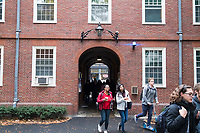 People walk through Dexter Gate between Harvard Yard and Massachusetts Avenue through Wigglesworth Hall, one of Harvard's freshman dorms, at Harvard University in Cambridge, Massachusetts, USA, on Mon., Oct 15, 2018.