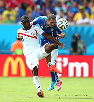Joel Campbell of Costa Rica and Giorgio Chiellini of Italy in action