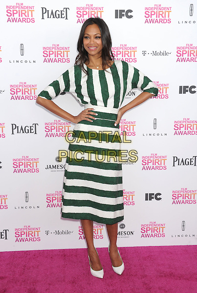 Zoe Saldana.2013 Film Independent Spirit Awards - Arrivals Held At Santa Monica Beach, Santa Monica, California, USA,.23rd February 2013..indy indie indies indys full length sleeves hands on hips dress shoes heels green white striped stripes .CAP/ROT/TM.©Tony Michaels/Roth Stock/Capital Pictures
