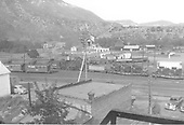 #453 switching in Durango yards.  Caboose #0565 and another caboose on the left.  A pair of flat cars is on the right, each with six combines as a load, one is #6507.  Early 1950s.  View from east (Strater Hotel?)<br /> D&amp;RGW  Durango, CO  1950-1952