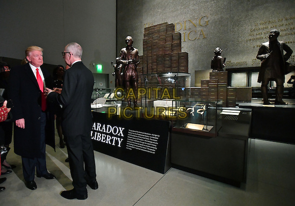 United States President Donald Trump visits the Smithsonian National  Museum of African American History and Culture in Washington, DC on February 21, 2017.  The &quot;Paradox of Liberty&quot; exhibit at right shows President Thomas Jefferson and other American leaders with slaves, each brick being a slave.   <br /> CAP/MPI/CNP/RS<br /> &copy;RS/CNP/MPI/Capital Pictures