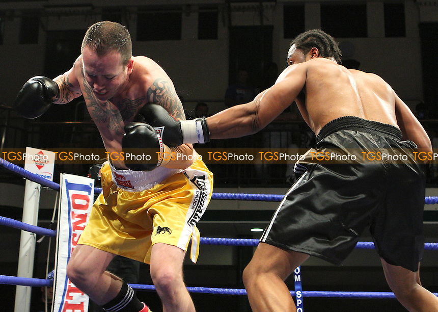 Chris Keane (black shorts) defeats Viktor Szalai in a Cruiserweight boxing contest at York Hall, Bethnal Green, promoted by Matchroom Sports / Barry Hearn - 18/09/09 - MANDATORY CREDIT: Gavin Ellis/TGSPHOTO - Self billing applies where appropriate - Tel: 0845 094 6026