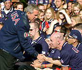 United States President George W. Bush shakes hands with Bert Barnes of Alpharetta, Georgia after making remarks to the 2004 United States Olympic and Paralympic teams on the South Lawn of the White House in Washington, D.C. on October 18, 2004.  <br /> Credit: Ron Sachs / CNP