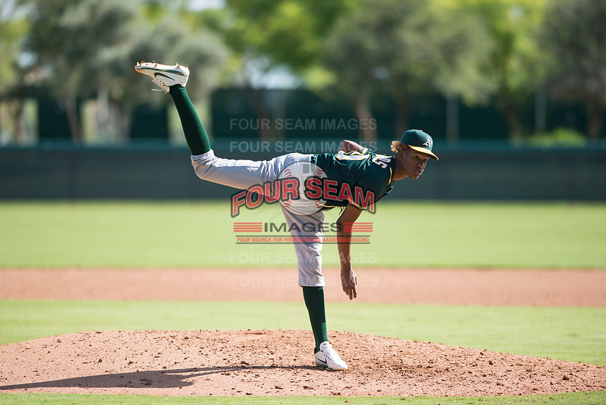 Oakland Athletics relief pitcher Wilkin Ramos (50) follows through on his delivery during an Instructional League game against the Los Angeles Dodgers at Camelback Ranch on October 4, 2018 in Glendale, Arizona. (Zachary Lucy/Four Seam Images)