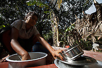 """A girl, displaced by  bombings in her town, washes dishes for the other displaced in the school where she is hosted together with other 400 families in Kinnyia, close to Trincomalee, in Eastern Sri Lanka on Sunday October 08 2006..The Sri Lanka civil was is an ongoing conf, The Sri Lanka civil was is an ongoing conflict on the island nation of Sri Lanka Since the 1983 """"Black July""""  pogrom there has been on and off civil war, mostly between the government and the Liberation Tigers of Tamil Eelam, or the LTTE, who want to create an independent state of Tamil Eelam in the north east of the island. It is estimated that the war has left 65000 people dead since 1983 and caused great harm to the population and economy of the country. A cease fire was declared in 2001, but hostilities renewed in late 2005. Following escalation of violence         in July 2006, a senior rebel leader declared the ceasefire null and void, although both sides later reaffirmed their commitment to the ceasefire agreement. Hundreds of people, including military personnel, rebels, and Tamil, Sinhalese and muslim civilians have been killed in fighting this year. Thousands of civilians have been displaced, many coming from areas already stroke by the dec 2004 Tsunami.."""