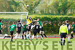 Killarney Celtic keeper Roy Kelliher rises to clear an inbound effort despite the pressure from Castleisland in the Denny Premier League final on Sunday.