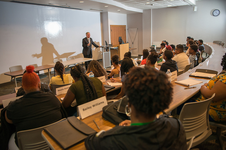 Ohio University President Duane Nellis talks with participants in the Junior Executives Business Program. Photo by Ben Siegel