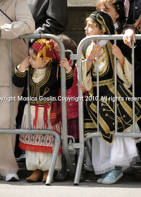 Greek Parade in New York City. Girls in traditional costumes watch the Greek Parade in New York City.