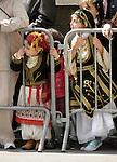 Greek Parade in New York City. Girls in traditional costumes watch the Greek Parade in New York City.