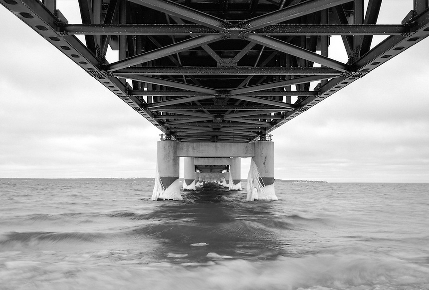 (Film) An underside view of the mighty Mackinac Bridge in black & white. Ilford Delta Pro 100 film.