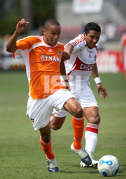 Houston Dynamo's Ricardo Clark (13) and Chicago Fire's Diego Gutierrez (8) fight for the ball at Robertson Stadium in Houston, TX on Saturday May 20, 2006. Chicago beat Houston 1-0.
