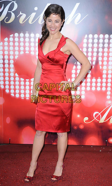 MYFANWY WARING.Attending the British Soap Awards 2010, London Television Centre, London, England, UK, 8th May 2010.arrivals  full length red dress hand on hip sleeveless open peep toe shoes gold clutch bag.CAP/DS.©Dudley Smith/Capital Pictures
