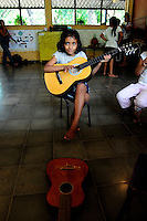 Young student of the 'Music for Hope' project, led by music teacher Eneida Amaya, based in the community of Amando Lopez, El Salvador.
