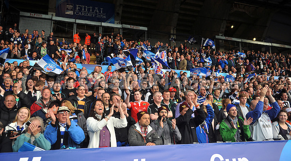 Bath fans in the crowd wave flags in support. Amlin Challenge Cup Final, between Bath Rugby and Northampton Saints on May 23, 2014 at the Cardiff Arms Park in Cardiff, Wales. Photo by: Patrick Khachfe / Onside Images