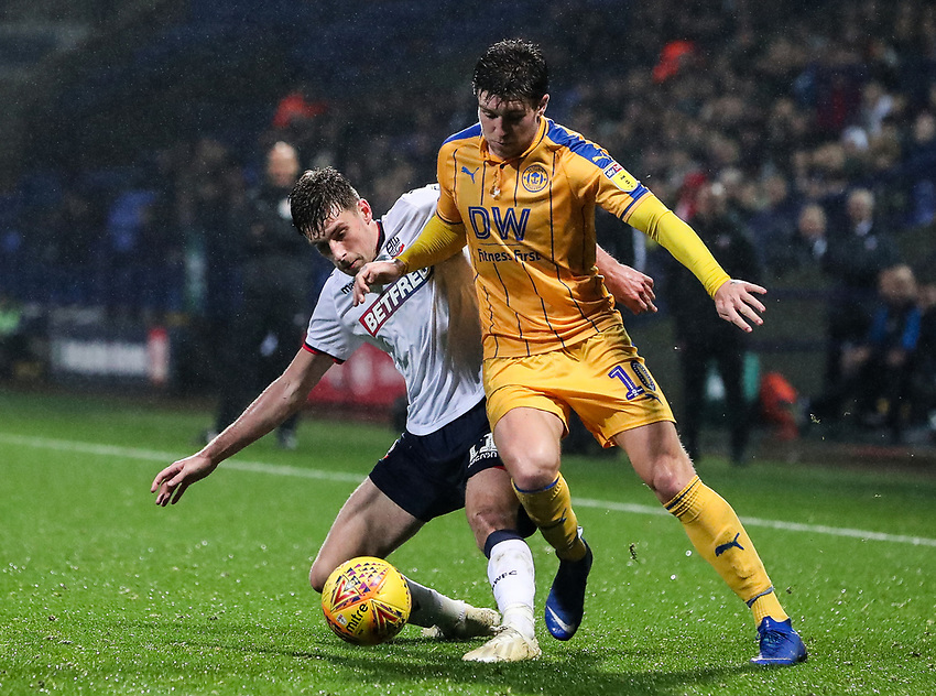 Bolton Wanderers' Joe Williams competing with Wigan Athletic's Josh Windass<br /> <br /> Photographer Andrew Kearns/CameraSport<br /> <br /> The EFL Sky Bet Championship - Bolton Wanderers v Wigan Athletic - Saturday 1st December 2018 - University of Bolton Stadium - Bolton<br /> <br /> World Copyright © 2018 CameraSport. All rights reserved. 43 Linden Ave. Countesthorpe. Leicester. England. LE8 5PG - Tel: +44 (0) 116 277 4147 - admin@camerasport.com - www.camerasport.com