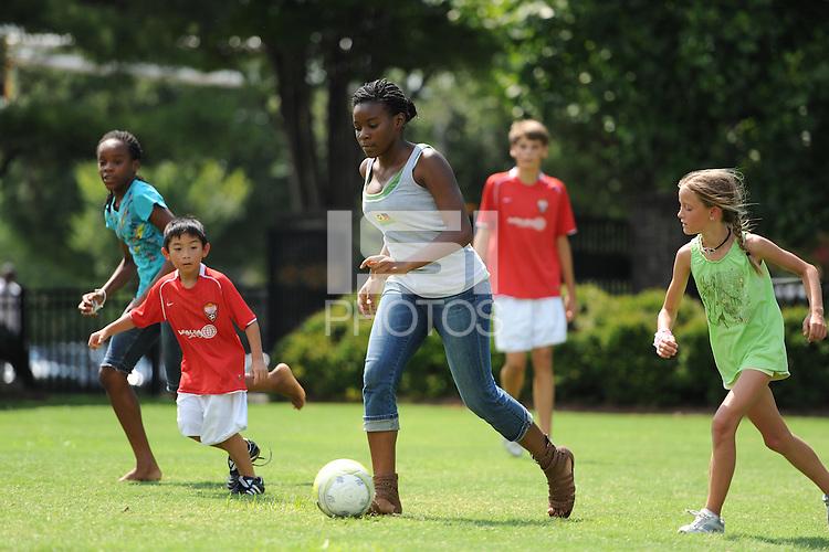 Kids play soccer during the Women's Professional Soccer (WPS) All-Star Fan Fest at Centennial Olympic Park in Atlanta, GA, on June 28, 2010.
