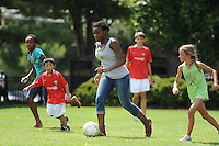 Kids play soccer during the Women's Professional Soccer (WPS) All-Star Fan Fest at Centennial Olympic Park in Atlanta, GA, on June 28, 2010.