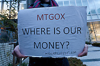 "Bitcoin trader, Kolin Burges, from the United Kingdom, holds a sign asking ""Mt Gox, Where is our money?"" as he protests in front of the abandoned offices of Tokyo-based Bitcoin exchange, Mt. Gox. Shibuya, Tokyo, Japan. Friday February 28th 2014. Mr Burges flew to Japan to personally confront the trading company over his inabilty to withdraw over 260,000 USD worth of the electronic currency. Mt. Gox officially filed for bankruptcy protection on February 28th 2014"