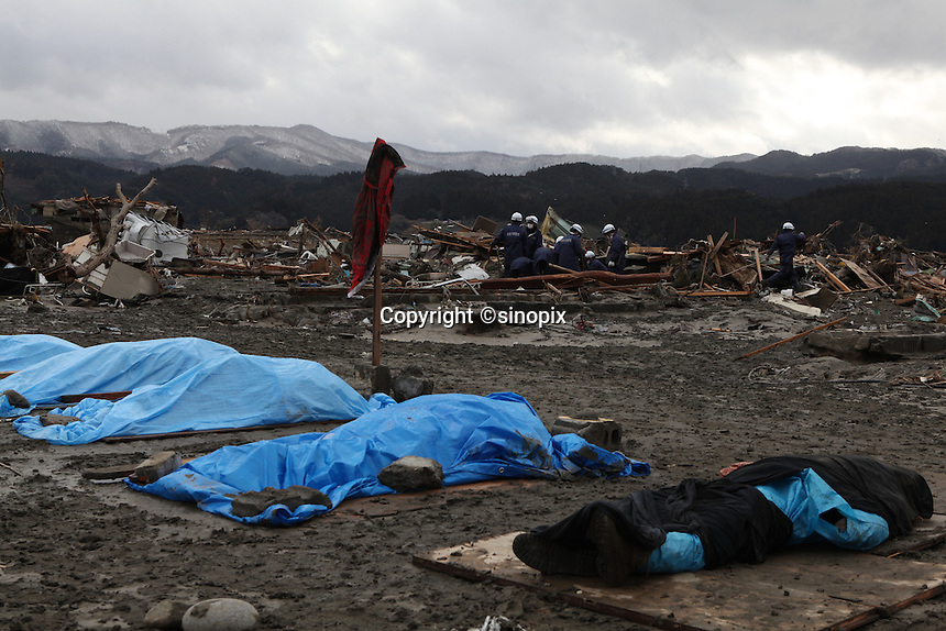 Dead bodies found and lay on ground, Rikuzentakata City, Iwate Prefecture, North East Japan. Rikuzentakata is one of the worst affected areas by the massive earthquake and tsunami that hit Northern East part of Japan on 11th.  5000 houses out of 8000 have been affected, over 1000 people still missing. Every town by the shores has been swept away by 10-15 meter high tsunami after the M10 earthquake. Every town by shores in the North East Japan has been swept away by the tsunami..16 Mar 2011